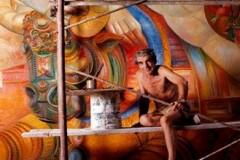 Mentor en 1974 réalisant la peinture murale